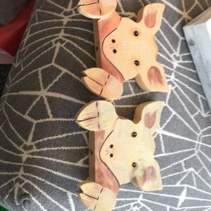 Pig set of two shelf sitters. Made of wood.